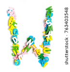 Small photo of Colorful wood alphabet letters on a white background,font letter W