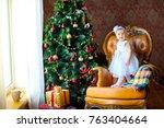 little girl in a beautiful...   Shutterstock . vector #763404664