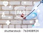 doctor pushing button faq... | Shutterstock . vector #763408924