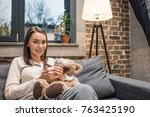 portrait of smiling woman with... | Shutterstock . vector #763425190