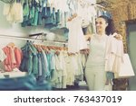 young cheerful female customer... | Shutterstock . vector #763437019