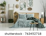 green bedding on king size bed... | Shutterstock . vector #763452718