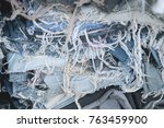 stack of old dirty jeans cloth | Shutterstock . vector #763459900