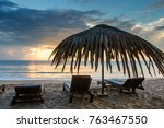 sun loungers with umbrella on... | Shutterstock . vector #763467550