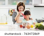 happy mother and child in... | Shutterstock . vector #763472869