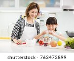 happy mother and child in... | Shutterstock . vector #763472899