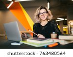 young stylish woman sitting at...   Shutterstock . vector #763480564