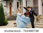 bride and groom dancing at... | Shutterstock . vector #763480738