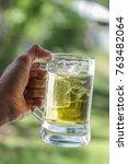 hand holding a mug of beer...   Shutterstock . vector #763482064