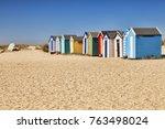 beach huts on the beach at...