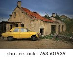 A Yellow Old Car Parked In...