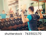 woman train with a coach in jym | Shutterstock . vector #763502170