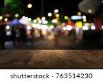 empty dark wooden table in... | Shutterstock . vector #763514230