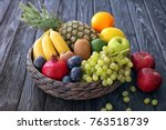 basket and fresh fruits on... | Shutterstock . vector #763518739