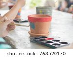 children are painting potted... | Shutterstock . vector #763520170