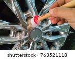 men's hands are cleaning wheels ... | Shutterstock . vector #763521118