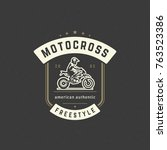 Motocross logo template vector design element vintage style for label or badge retro illustration. Motorcycle silhouette.