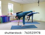 boy and girl perform yoga... | Shutterstock . vector #763525978