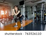 woman exercise doing squat...   Shutterstock . vector #763526110