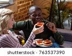 happy woman feeding african... | Shutterstock . vector #763537390