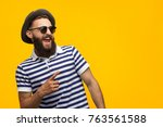 young bearded hipster in cap... | Shutterstock . vector #763561588