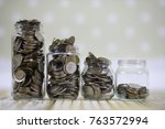 accumulated coins stacked in... | Shutterstock . vector #763572994
