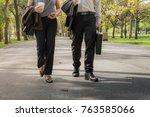 business people walking on a... | Shutterstock . vector #763585066
