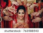 stunning indian bride dressed... | Shutterstock . vector #763588543
