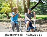 asian boy with friend ride a... | Shutterstock . vector #763629316