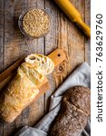 Small photo of Baking homemade bread on wooden background top view moke up