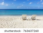 two sunbeds at caribbean sea... | Shutterstock . vector #763637260