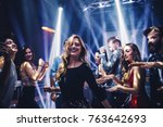 shot of a young woman dancing... | Shutterstock . vector #763642693