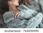 woman in a sweater   Shutterstock . vector #763650490