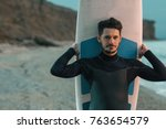 portrait of a surfer with sup... | Shutterstock . vector #763654579