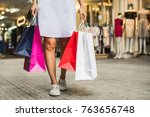 young woman with shopping bags... | Shutterstock . vector #763656748