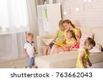 mom reading a book for children.... | Shutterstock . vector #763662043
