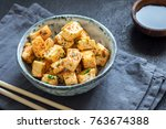 stir fried tofu in a bowl with... | Shutterstock . vector #763674388