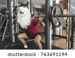 young boy performs squats on... | Shutterstock . vector #763691194