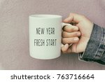 hands holding a coffee mug with ...   Shutterstock . vector #763716664