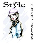fashion woman in cap. hand... | Shutterstock .eps vector #763719310
