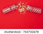 christmas crackers on a red... | Shutterstock . vector #763732678