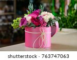 pink box with flower bouquet on ... | Shutterstock . vector #763747063
