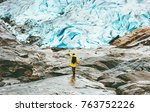 woman hiking at nigardsbreen... | Shutterstock . vector #763752226