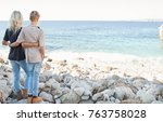 rear view of mother and... | Shutterstock . vector #763758028