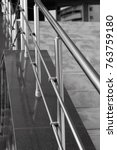 Small photo of aluminum metal handrail of the stairs parallel into the distance
