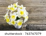 daffodils on weathered table | Shutterstock . vector #763767079