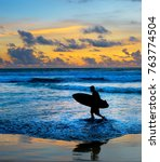 silhouette of surfer on the... | Shutterstock . vector #763774504
