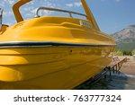 Yellow Motor Boat On The Beach...