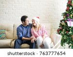 pretty young couple relaxing on ... | Shutterstock . vector #763777654