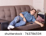 a young guy fell asleep on the... | Shutterstock . vector #763786534